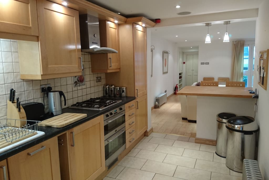 Large open plan galley kitchen with breakfast bar