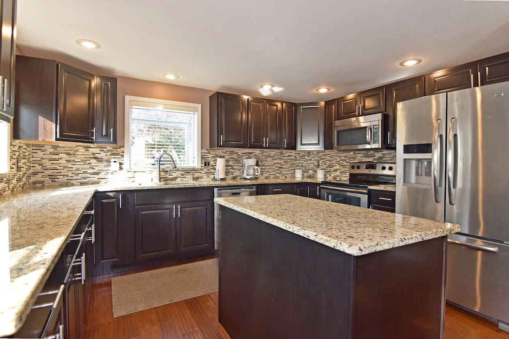Elegant tiling and countertops in the kitchen.
