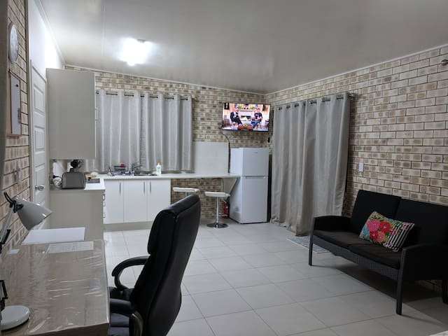 Spacious studio apartment for your comfortable stay with a small but functional kitchen, basic equipment, medium size fridge and smart TV.