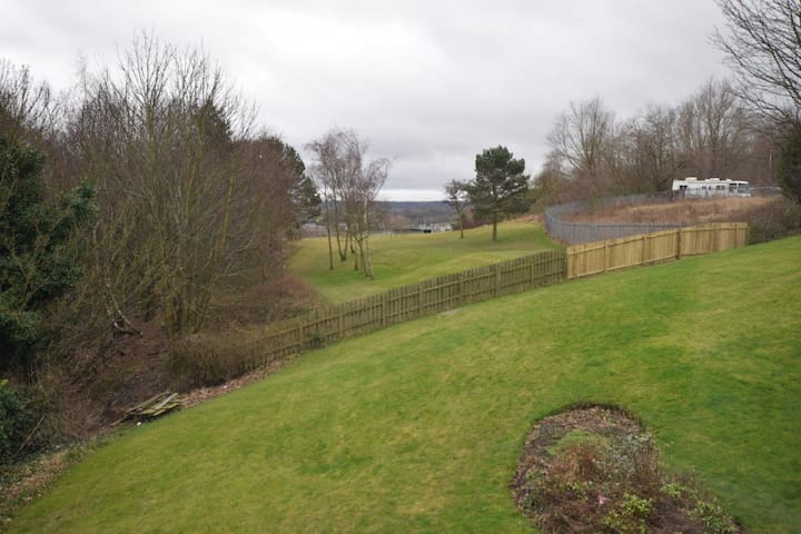 View from lounge across the communal garden and Roseberry Grange Golf Course