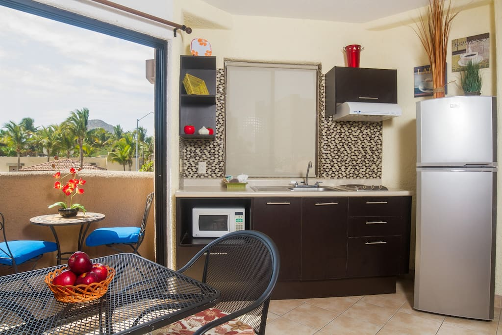 Improved kitchen w/big fridge to storage the best ingredients for your meals. 6ft double glass sliding door on your left leads to terrace and can be closed for keeping noise out.