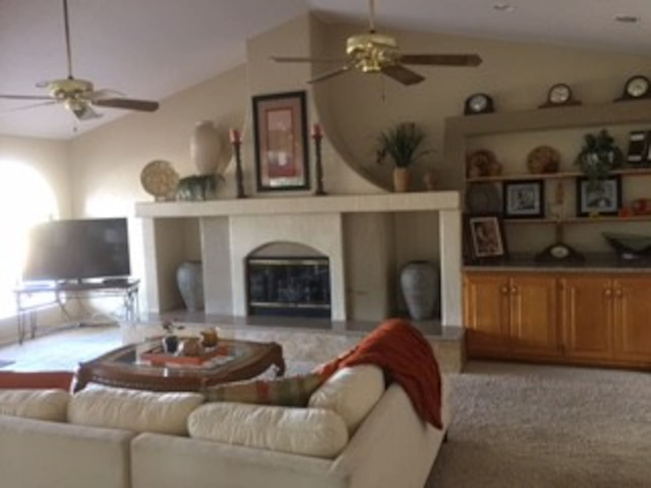 "Living Room with wetbar, 55"" Smart TV, Gas fireplace, direct access to covered patio"