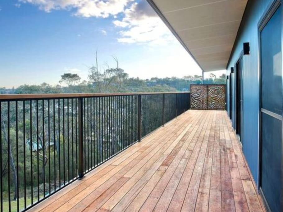 Huge deck hugs all bedrooms and living spaces