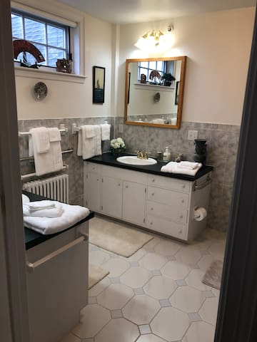 A spacious private on suite bathroom with double sinks