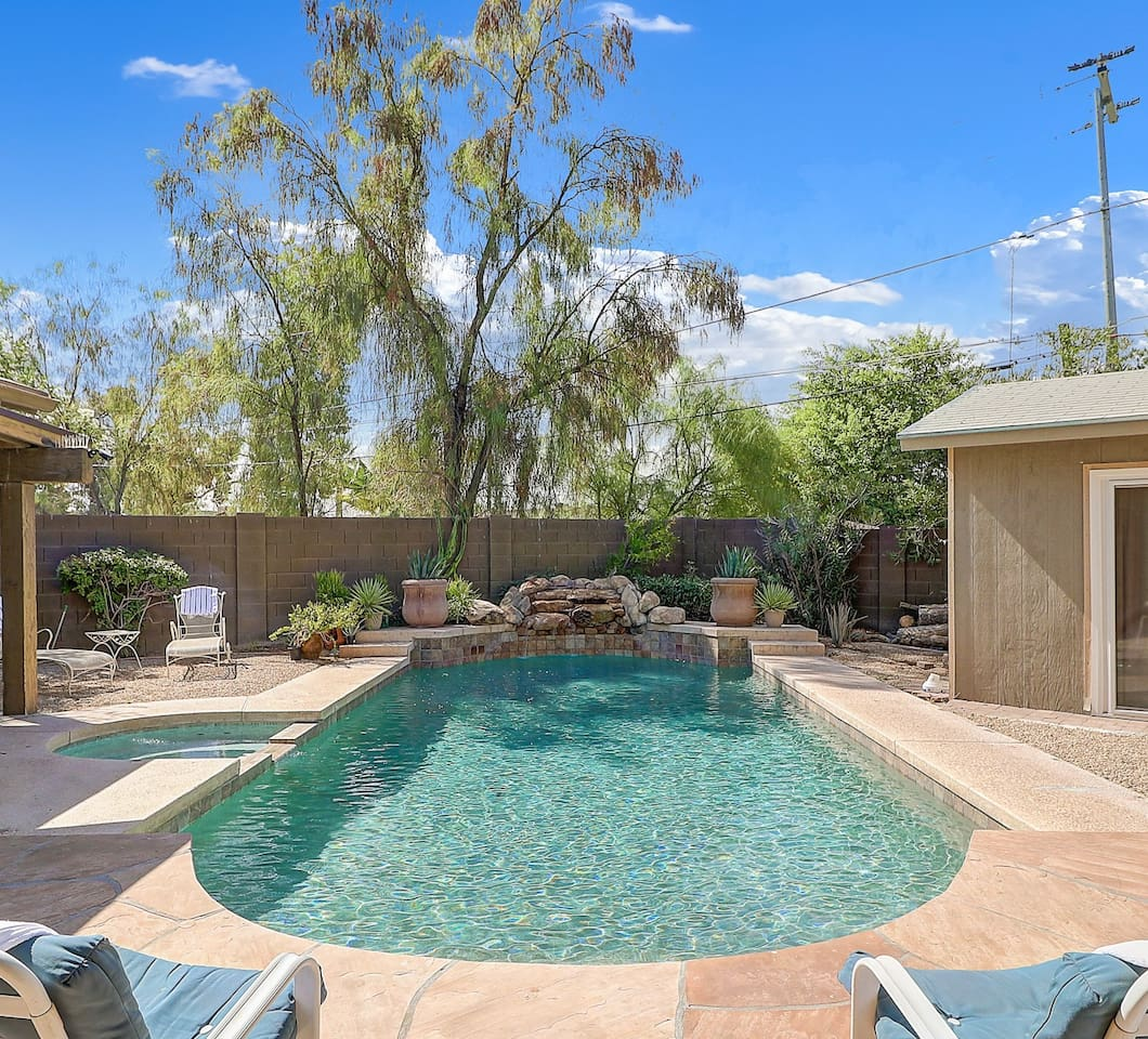 The pool and spa are right outside the back sliding den door. In cool weather you'll enjoy the heated pool and wood buring outdoor stove!!  A very cozy setting compete with a working waterfall!!