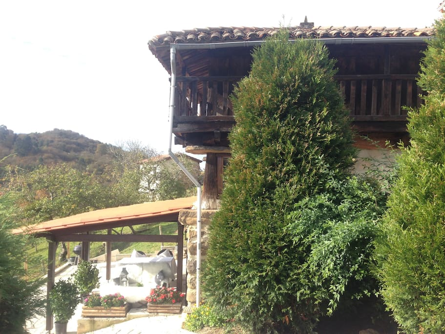 Side view of 'La Casina'. With Private Garden and outdoor area at LG Level. Open kitchen and living area at Ground Floor Level. And through an internal handmade staircase at 1st floor level the Master bedroom with full en-suite