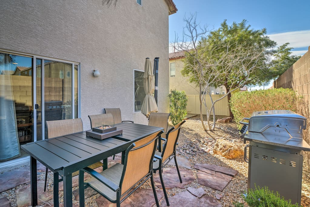 This spacious home features a well-appointed furnished patio.