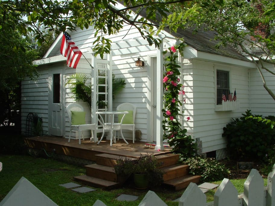 surrounded by picket fence and flowers