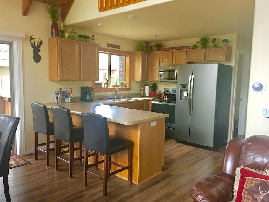 Kitchen features all new appliances, breakfast bar as well as dishes, pots, pans, utensils and all you could imagine for meal prep!