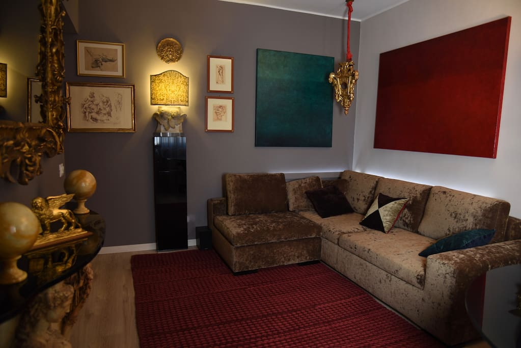 Overview of the living room area. The new mink colour chenille velvet sofa in the background.