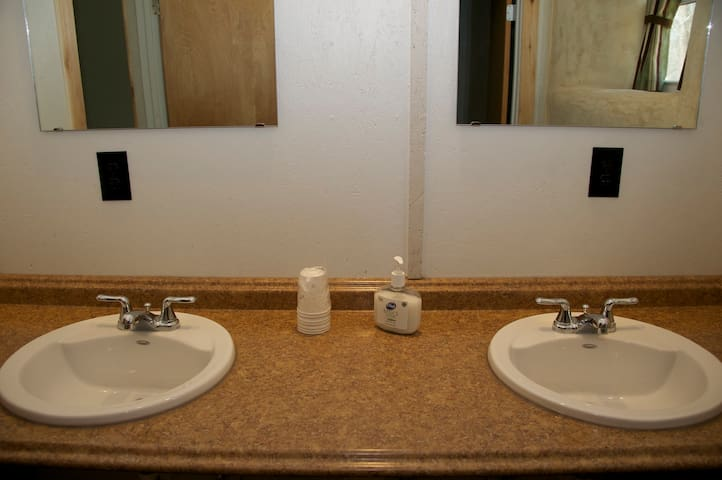 Two lavatories, full shower and dual flush, water saving toliets.