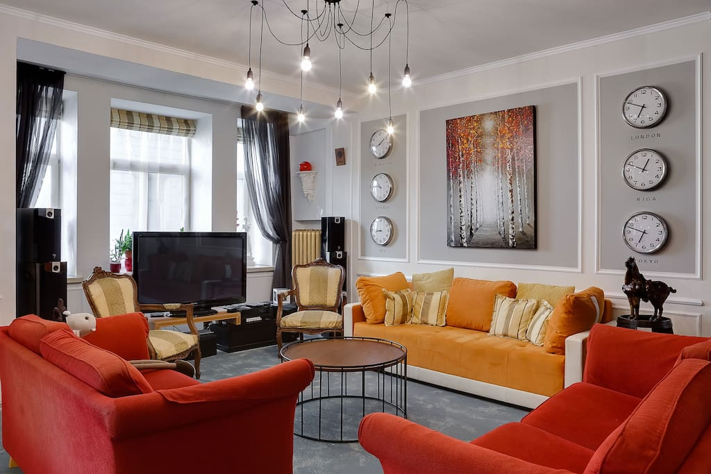 The living room with where an orange big sofa-bed is suitable for comfortable sleeping of two (140cm*200cm)