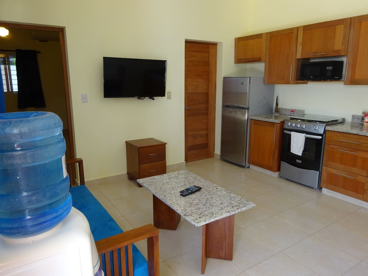 The kitchen is fully equipped with everything you need to cook a meal or make a tropical drink. The door that is shut is for a half bath room.