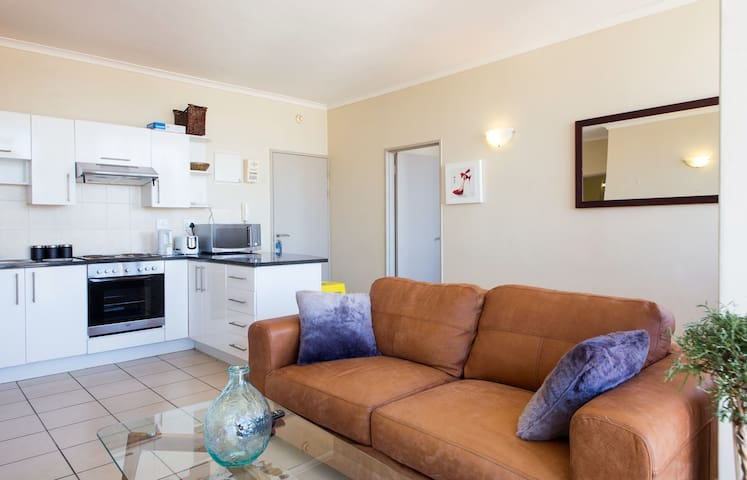 Open plan kitchen fully stocked with all utensils and cooking equipment. Including stove, dishwasher, fridge, microwave, oven & hob, cutlery and crockery etc.