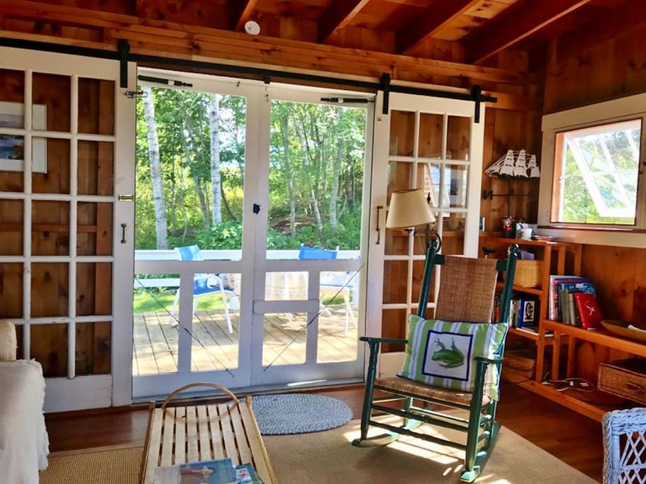 Sliding french doors open off of living/dining area to back deck