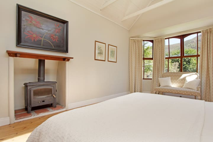 main bedroom with wood burning fireplace