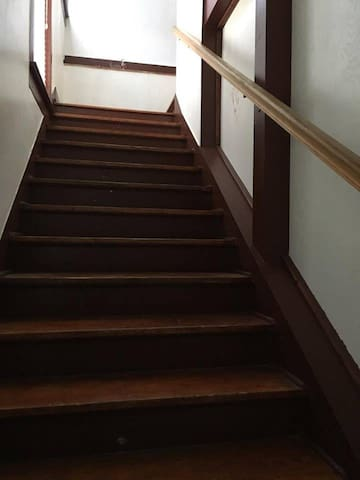 Stairwell to upstairs living quarters.