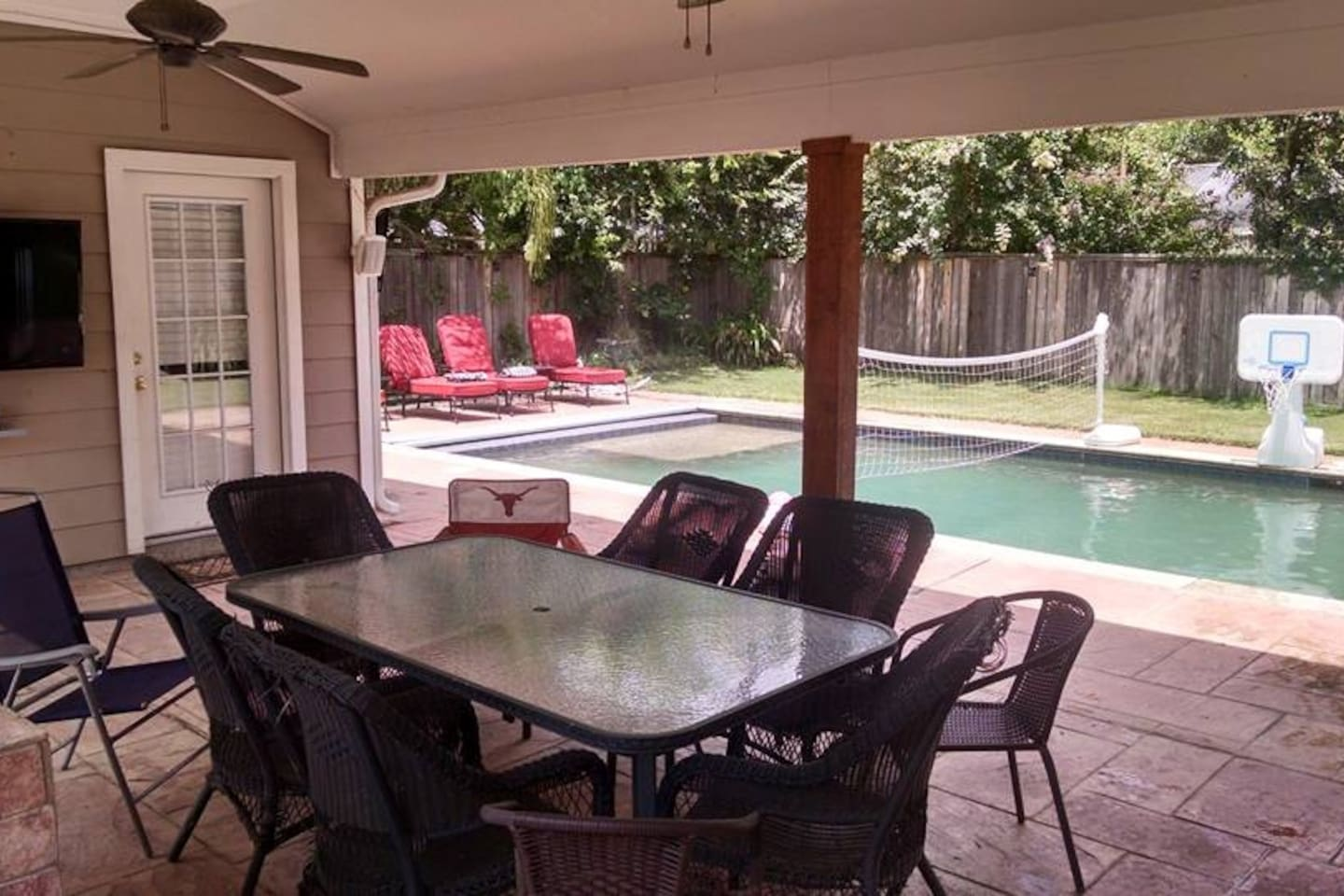 backyard pool & patio, complete with tv and surround sound speakers. great for watching the game