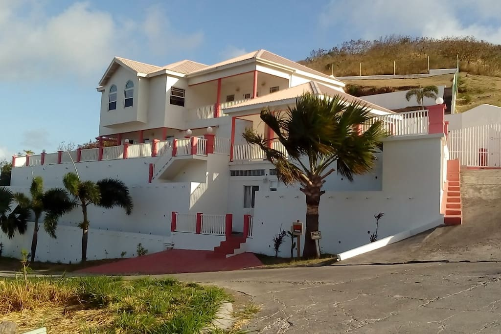The house is located on top of a hill overlooking Frigate Bay, the Marriott Hotel and its golf course.