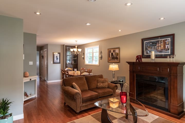 Our bright and cheerful home features open concept living, beautiful hardwood floors, and all high-end furniture. This is our personal home and is decorated as such!