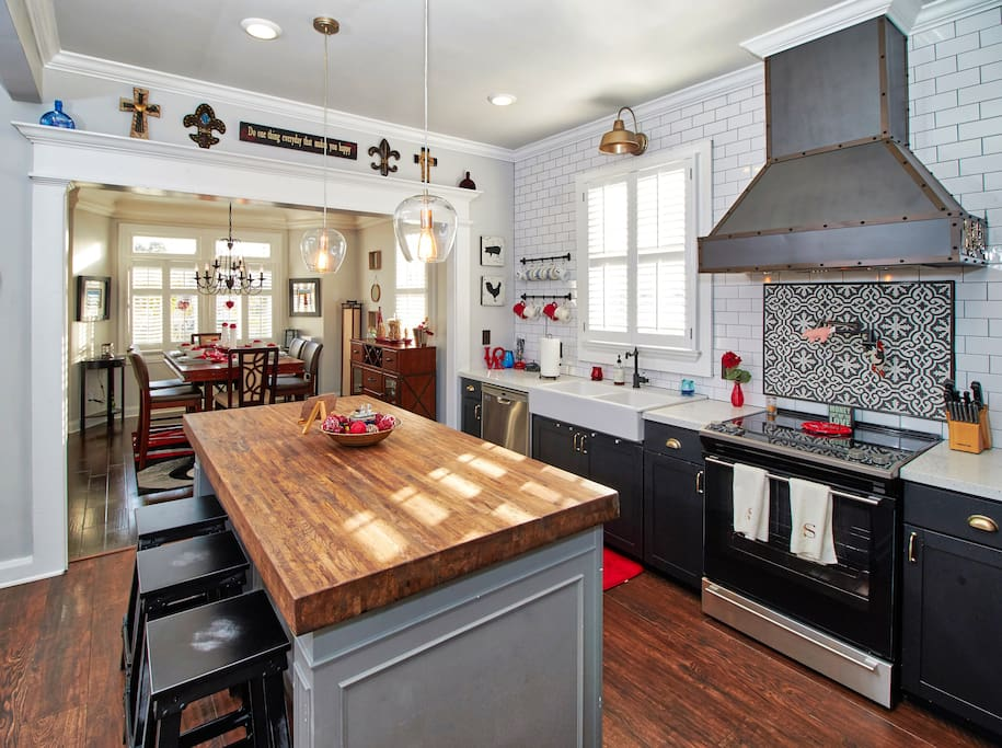 Spacious chefs open kitchen with butcher block island and dining