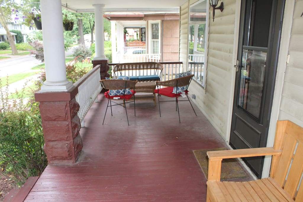 View of front porch with bench and seating area