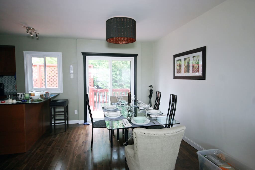 Dining room with patio doors and deck in background