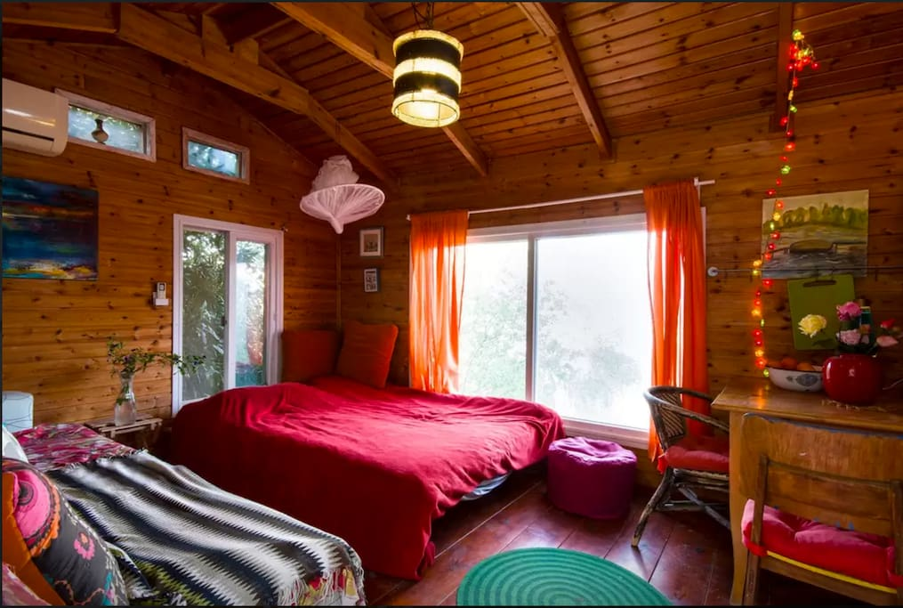 the Airbnb photographer did a good job:) in reality its smaller. just the size of a normal  room