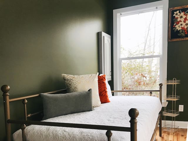 A day bed with a trundle adds more comfy sleeping spaces.