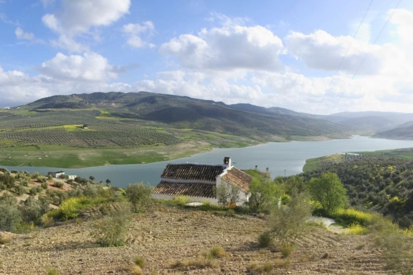 View from the rear of the cottage showing the stunning panoramic views over the lake, olive groves and mountains.