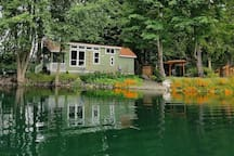 This exceptional tiny house, located on a tranquil pond in Sequim, Washington, is the perfect place for your Olympic Peninsula escape for one, two—or three!