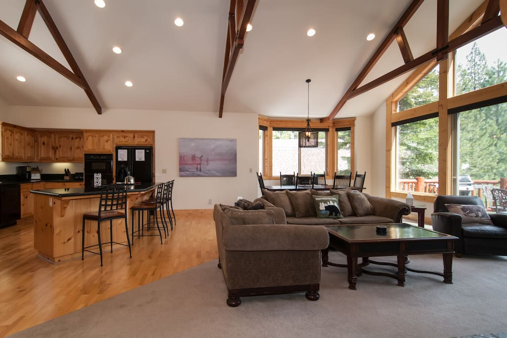 Great Room on upper level, kitchen to the left, dining area in back, and sitting area in front
