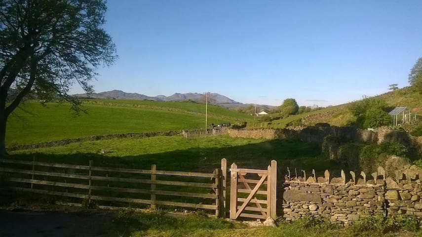 View of the Coniston Range from the Lounge. Field through the gate for use by the guests