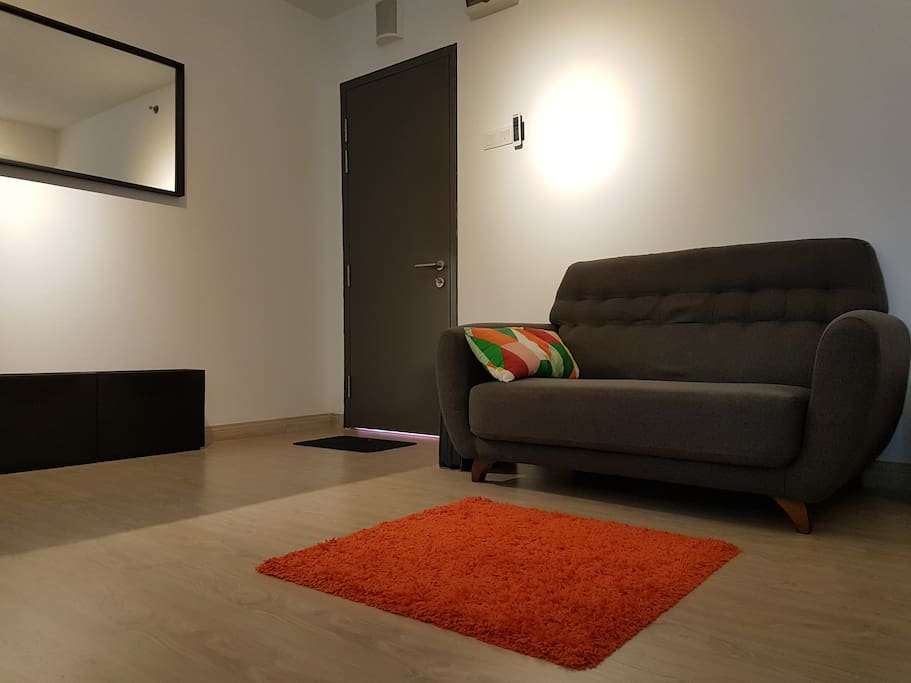 Living room with sofa, bean bag and shoe cabinets
