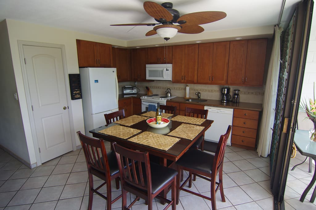 Spacious kitchen with granite counters and new counter-top height table with 6 chairs