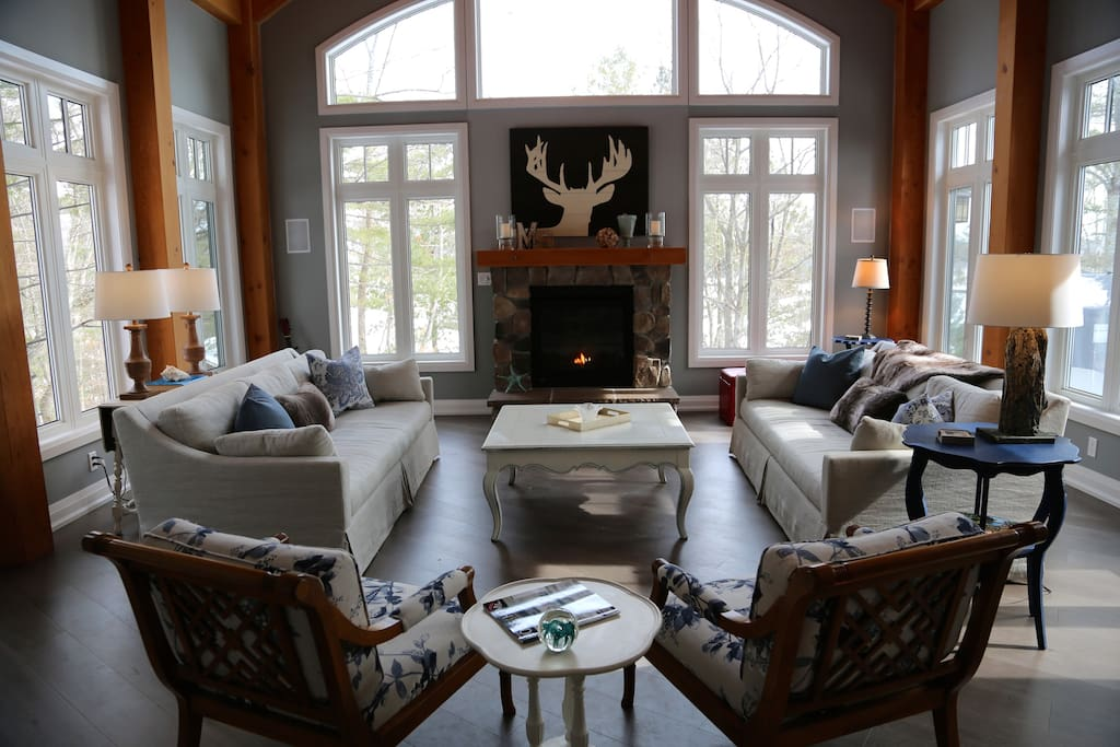 Muskoka Soul -Cliff Bay House - The Great Room with south views from 8 windows in a 18x20 room