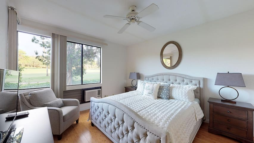 Master bedroom. Brand new memory foam bed with new sheets, pillows and comforter. Also there is an AC unit, chair, and lamps with USB plugs. And, there's a beautiful golf course view.