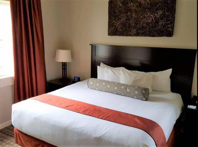 Comfy queen bed in the master bedroom