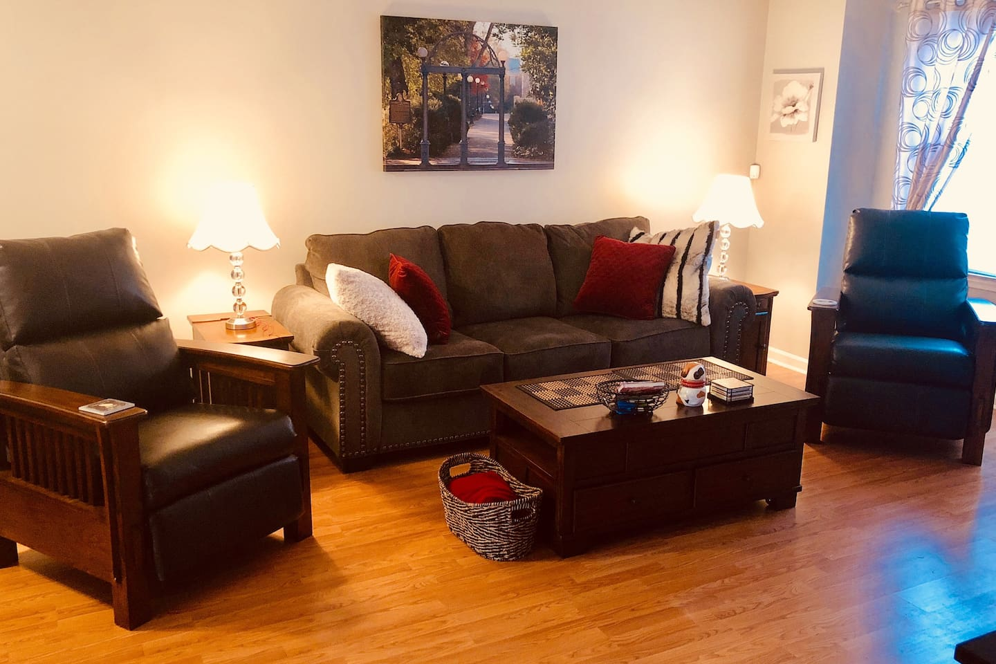 Living Room Area - Warm, welcoming and functional!  (Chargers and outlets in both end tables, recliners and cozy pillows, coffee table top comes up into table for dining in front of the TV.)  Sofa opens to a Queen size bed.