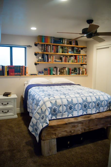 Comfortable queen bed! Bed frame is made from my grandfathers childhood cabin, topped with a  bed spread hand quilted by my grandmother. Best of all is the small library filled with wife's favorite books that she is acquiring.