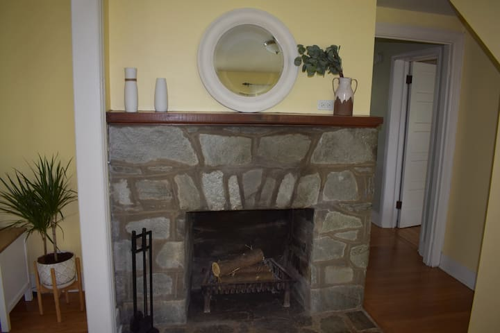 Enter through the front door and be greeted by Heart Gate's original stone fireplace.