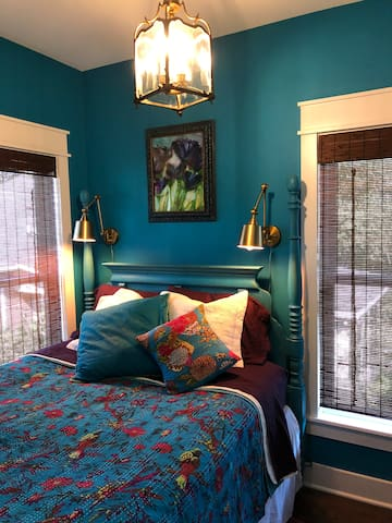 Our blue beauty bedroom is ever so tranquil. The lovely color  calms the spirit & with both wood shades & blackout shades you can chose to take a nap any time of day, or let the sun shine in through two big bright windows.