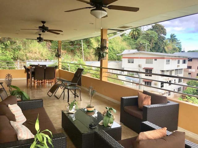 Large  covered outdoor patio perfect for entertaining with an amazing view of the sea.