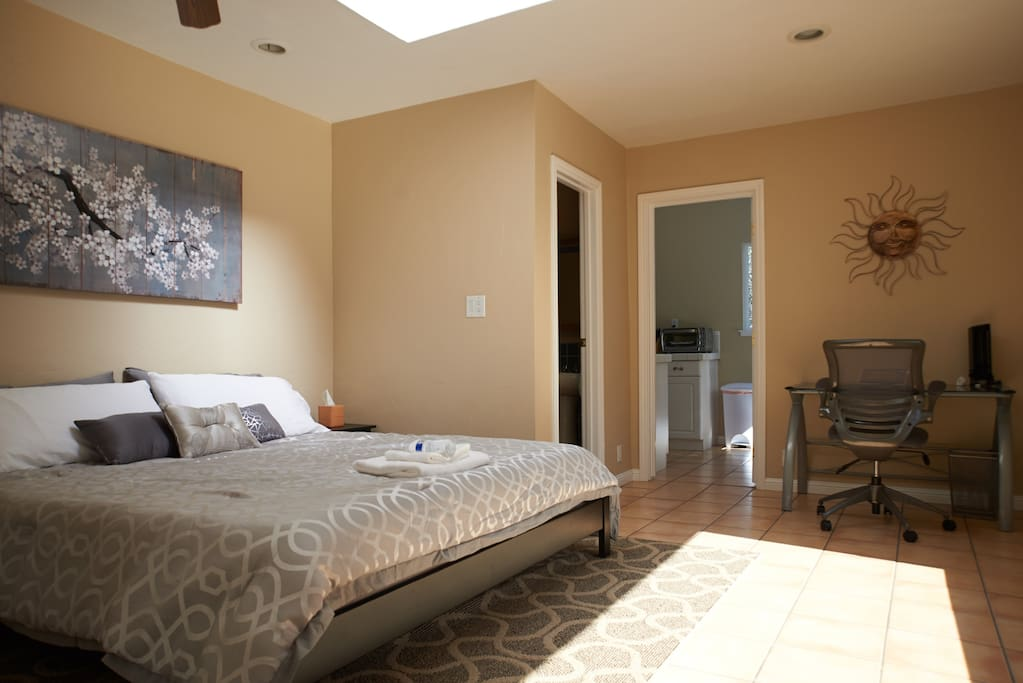Bedroom #1:  Bright and airy with a sunlight and large bay window.  Executive desk and chair in the bedroom.
