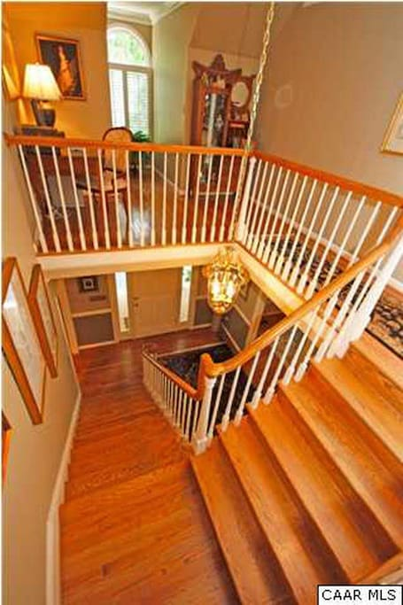 Staircase leading to 2nd floor with 4 BR's 2 Full Baths & computer work area