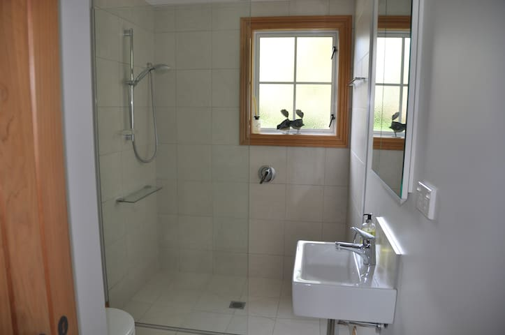 Spacious shower with continuous hot water