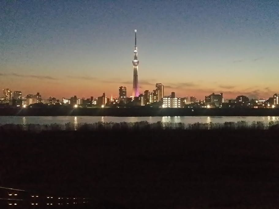 Beautiful sunsets behind Tokyo Sky Tree from the nearby riverside. Tokyo Tower and Mt. Fuji can be seen on clear days