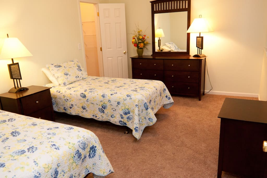 2nd bedroom with large dresser and two night stands.