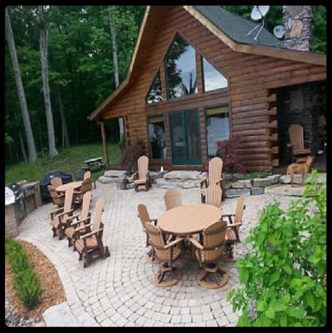 BBQ and brick paver patio area with brand new top of the line luxury patio furniture.