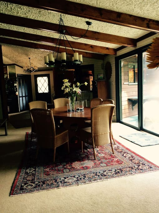 Formal dining area, large sliding glass door which looks out to the Roaring Fork.
